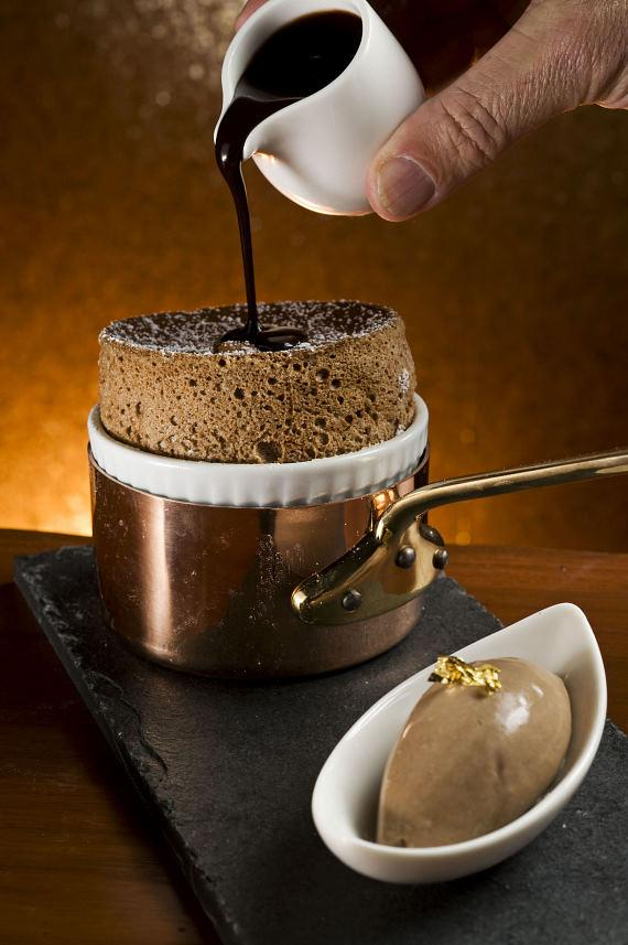 Chocolate Soufflé with chocolate ganache and house-made ice cream