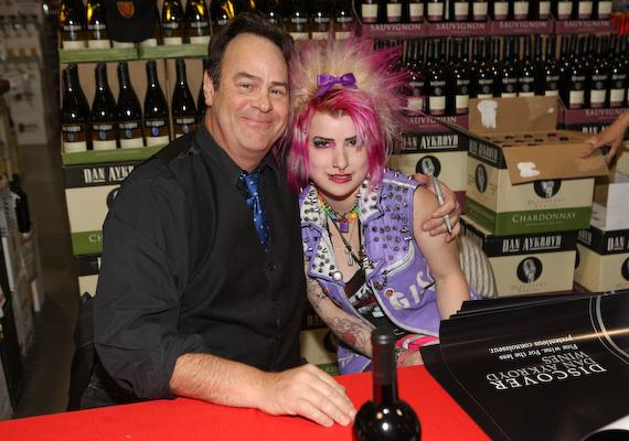 Dan Aykroyd and a fan at bottle signing event