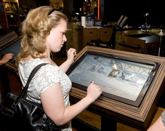 A guest browses samples of tattoo artwork