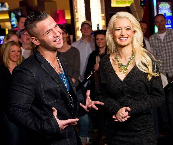 Peepshow star Holly Madison interviews Jersey Shore's Mike 'The Situation' Sorrentino on her new post as a correspondent for EXTRA TV