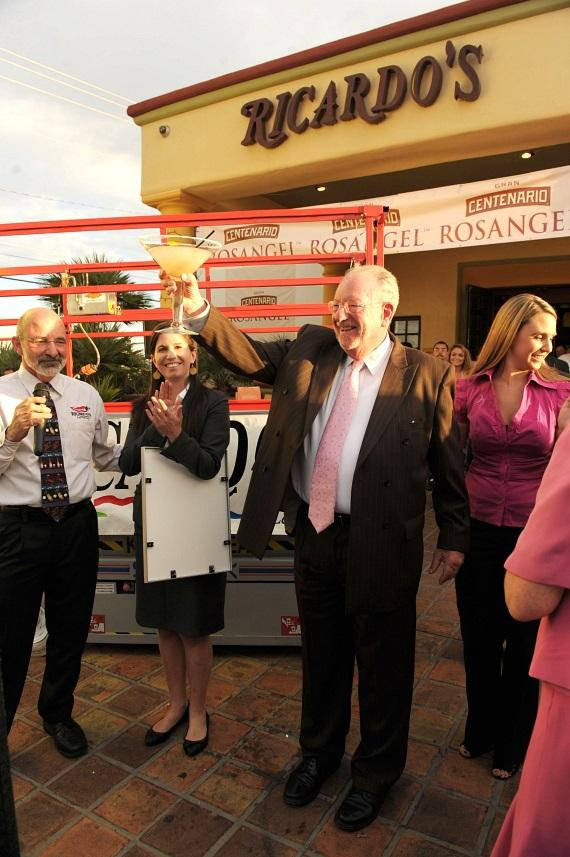 "Mayor Oscar B. Goodman toasting with Bob Ansara, owner of Ricardos, to the announcement from Kimberly Partrick, Guinness Official, that Ricardo's Mexican Restaurant and ROSANGEL Tequila officially broke the Guinness World Records® of 7,627 gallons for the ""World's Largest Margarita."""