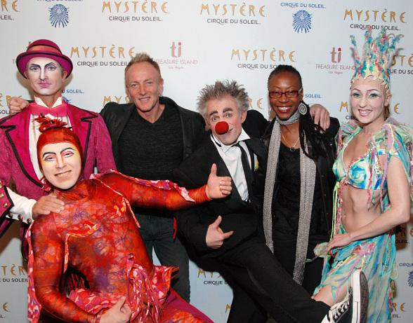 Musician Phil Collen and wife Helen Simmons with characters from Mystère by Cirque du Soleil