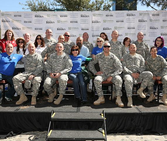 405th Civil Affairs Battalion, New York-New York Pres. Cynthia Kiser Murphey, hotel exec Brent Cook, head-shavers and Tournament of Kings cast members pose at St. Baldrick's Day