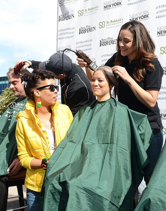 Participants get haircuts during St. Baldrick's Day Fundraiser in Las Vegas