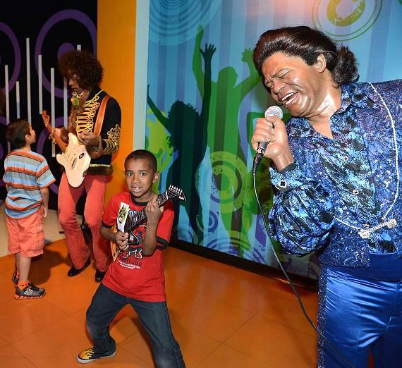 Childred pose withwax figure of James Brown at Madame Tussauds Las Vegas