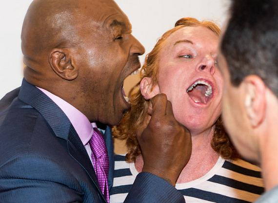 Mike Tyson goes for Carrot Top's ear at the opening of MIKE TYSON: Undisputed Truth - Live on Stage at MGM Grand