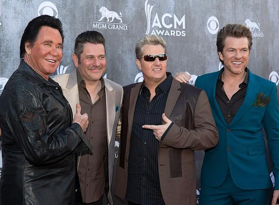Wayne Newton with Jay DeMarcus, Gary LeVox and Joe Don Rooney of Rascal Flatts at 49th ACM Awards in Las Vegas