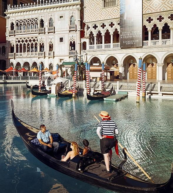 Guests enjoy an outdoor gondola ride at The Venetian Las Vegas