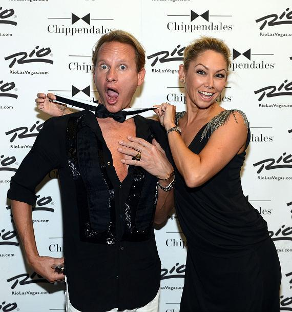 Fashion expert Carson Kressley and pro dancer Kym Johnson arrive at Chippendales.