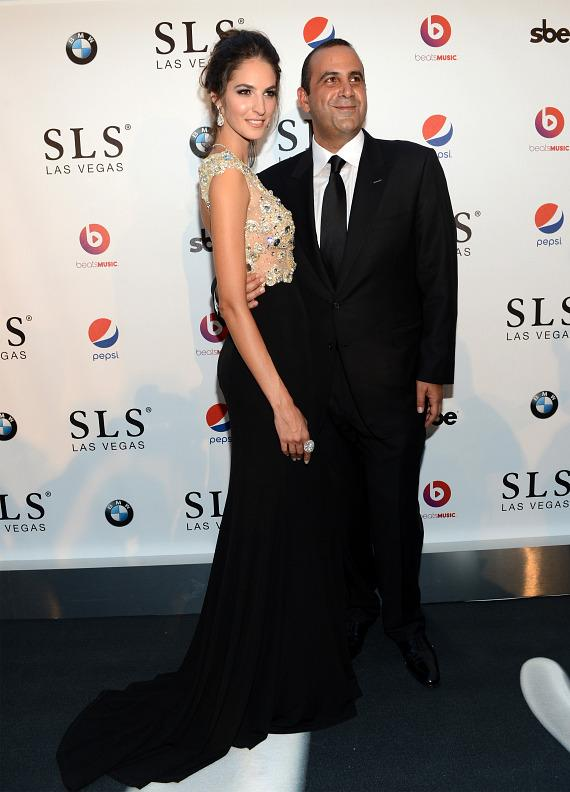 Model Emina Cunmulaj and Founder, Chairman and CEO of sbe, Sam Nazarian attend the SLS Las Vegas grand opening celebration