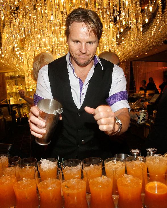 The Cosmopolitan of Las Vegas mixologist serving signature drinks at Uptown/Downtown