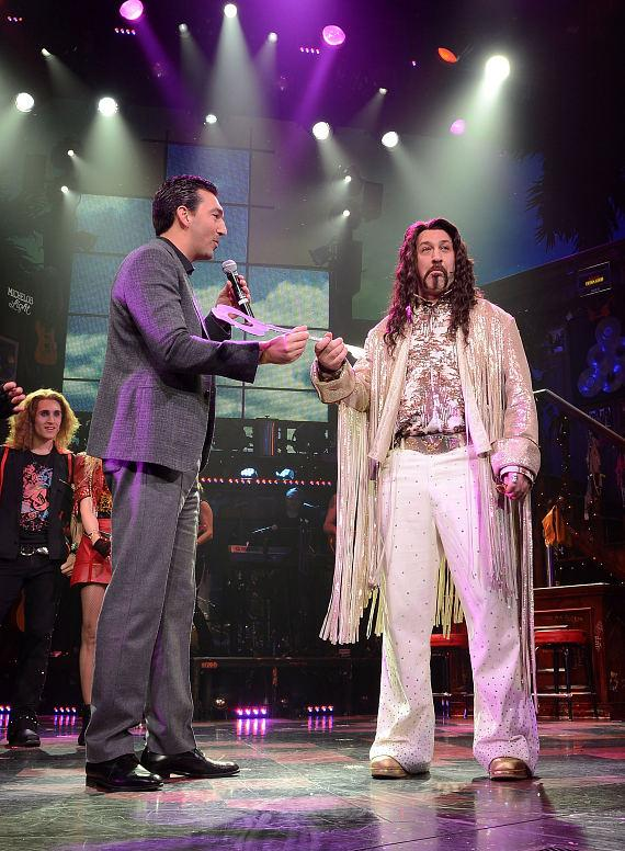 Vice President of food and beverage at the Venetian/Palazzo Sebastian Silvestri presents ROCK OF AGES guest star Joey Fatone with the key to Bourbon Room at The Venetian Las Vegas