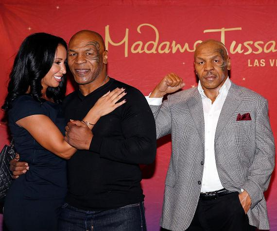 Mike Tyson and wife KiKi with World's First Mike Tyson Madame Tussauds Wax Figure in Las Vegas