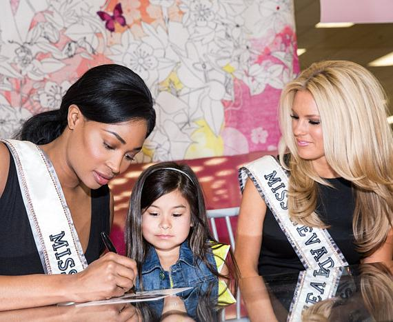 Miss USA 2013 Nana Meriwether and Miss Nevada USA 2013 Chelsea Caswell sign autographs for troops and their familes at Nellis Air Force Base
