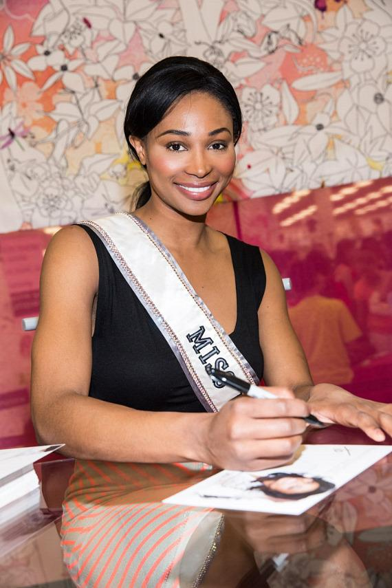 Miss USA 2013 Nana Meriwether signs photos at Nellis Air Force Base