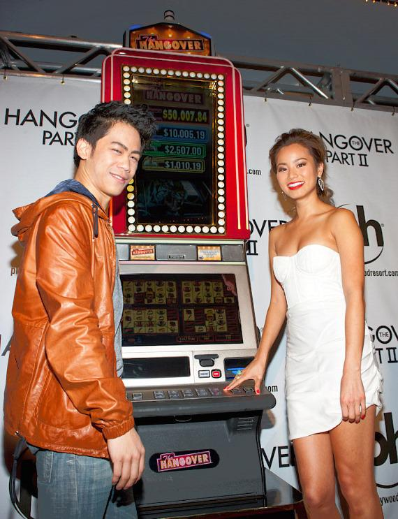 Mason Lee and Jamie Chung with IGT Hangover Slot Machine