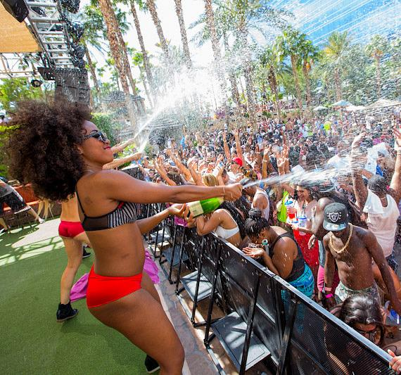 Crowd gets cooled off with champagne at REHAB at Hard Rock Hotel & Casino in Las Vegas
