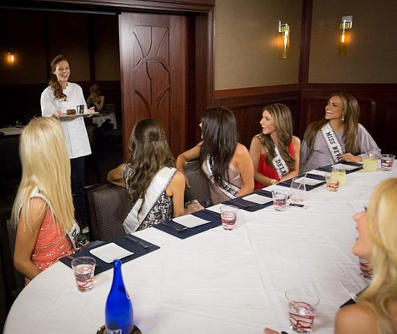 Miss USA Alyssa Campanella presents her dessert to other Miss USA contestants