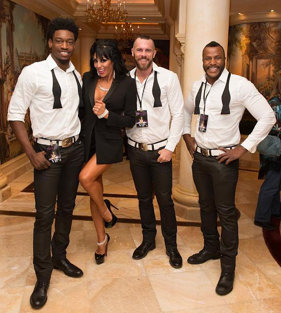 Jennifer Romas with cast members of Chippendales
