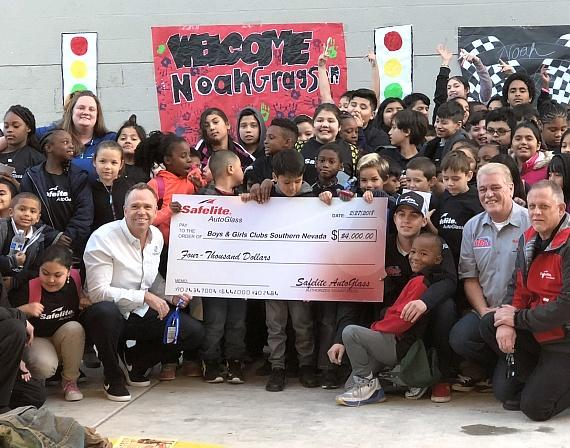 Members of the Safelite AutoGlass team surrounded by Club kids and staff after presenting a $4,000 check