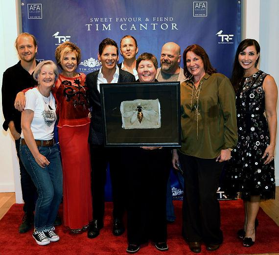 Mac Reynolds, Annmarie Wilmeth, Heidi Leigh, Tim Cantor, Chad Sampson, Rick Harrison and Amy Cantor attend Tim Cantor's Las Vegas art exhibit at AFA Gallery at the Fashion Show Mall