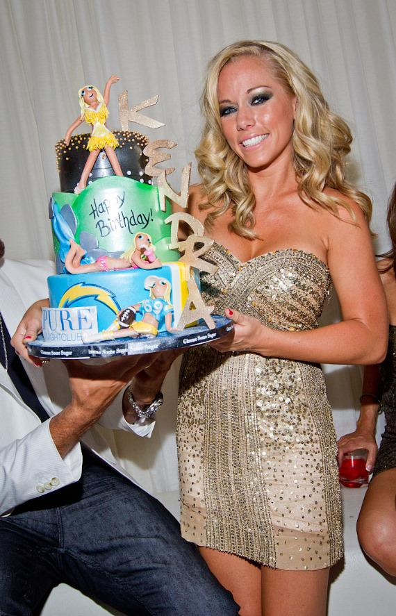 Kendra Wilkinson-Baskett with birthday cake at PURE Nightclub