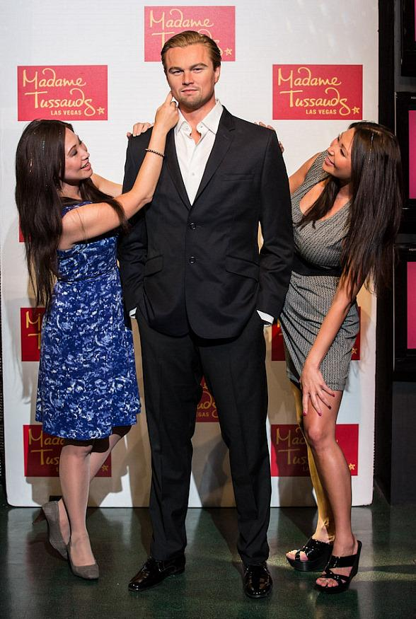 Guests interact with Leonardo DiCaprio wax figure at Madame Tussauds Las Vegas