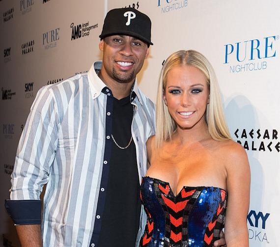 Hank Baskett and Kendra Wilkinson-Baskett on red carpet at PURE Nightclub