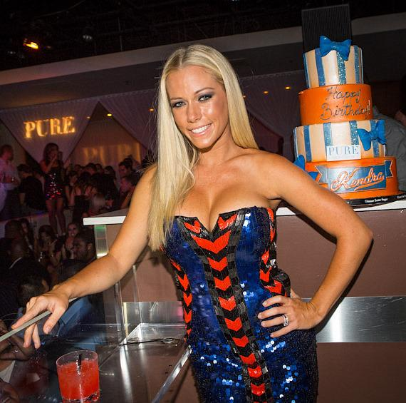 Kendra Wilkinson-Baskett inside PURE Nightclub with cake in background