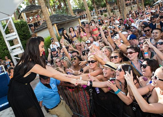 Kim Kardashian shakes hands with fans at REHAB Sundays at Hard Rock Hotel & Casino