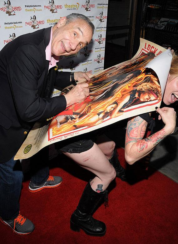 Lloyd Kaufman signs a poster at the Las Vegas premiere screening of Father's Day