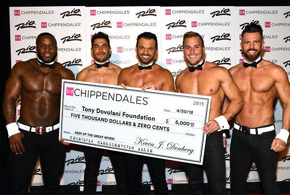 Chippendales dance captain Ryan Kelsey and Chippendales Managing Partner Kevin Denberg surprised Dovolani with a check for $5000 in support of Dovolani's Foundation