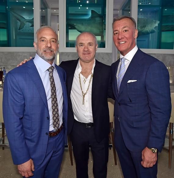 Artist Damien Hirst (C) with Palms owners Frank and Lorenzo Fertitta