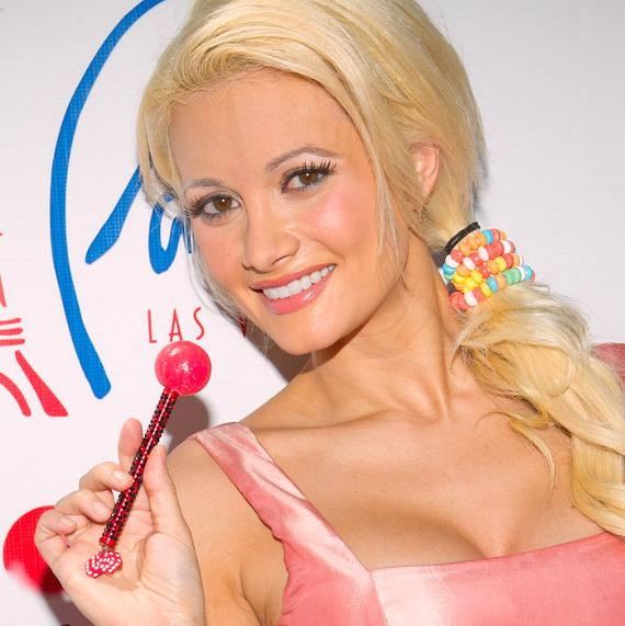 "Holly Madison poses with Sugar Factory's ""Vegas"" Couture Pop in honor of National Lollipop Day at Paris Las Vegas"