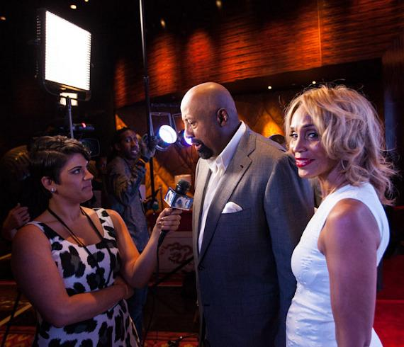 Los Angeles Clippers Assistant Coach Mike Woodson with wife Terri interviewed by TV reporter