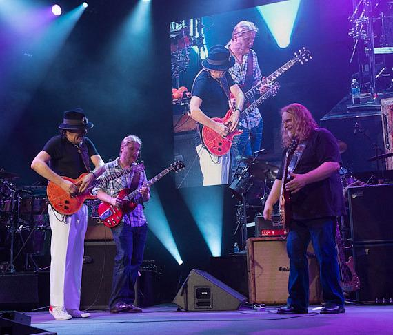 Carlos Santana performs with Allman Brothers Band members Warren Haynes and Derek Trucks in Columbia, Maryland