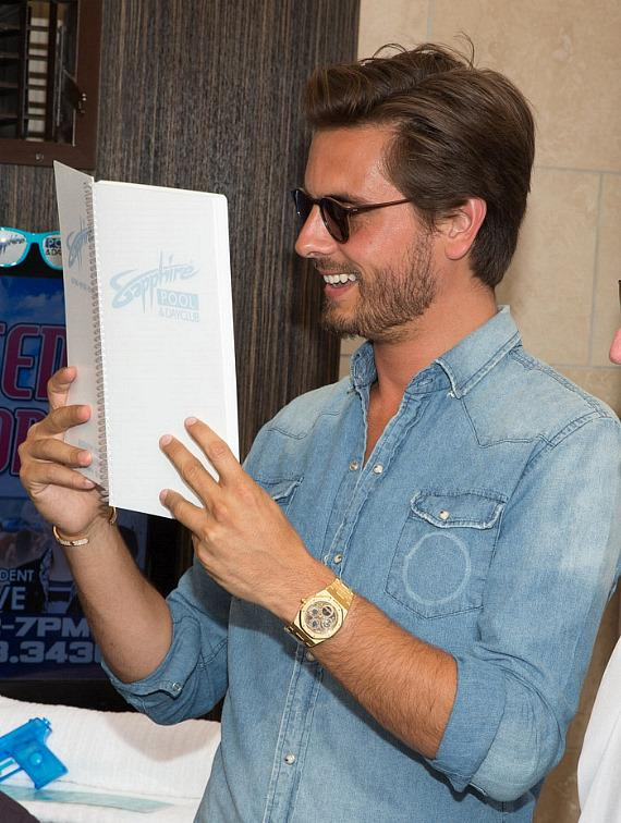 Scott Disick checks the menu at Sapphire Pool & Dayclub
