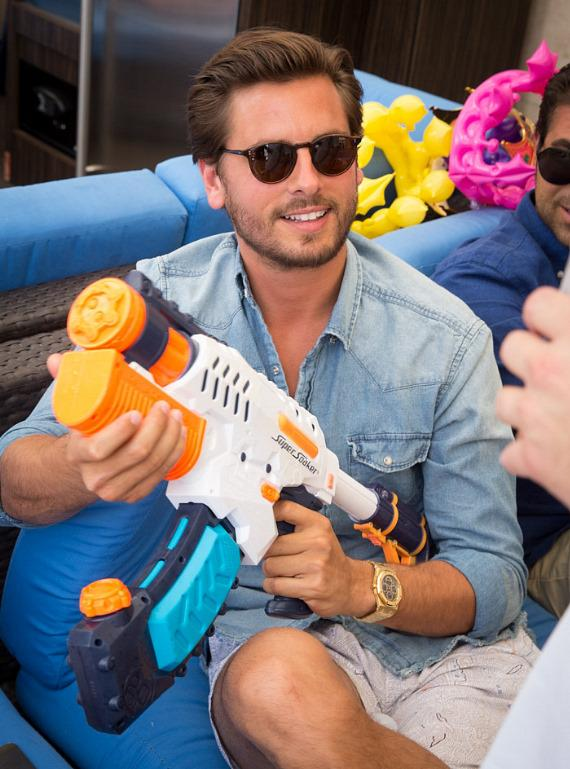 Scott Disick with a Super Soaker at Sapphire Pool & Dayclub