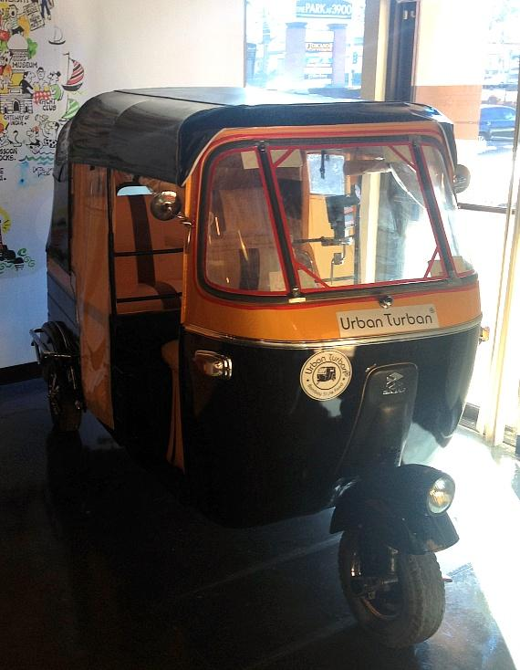 """The mascot of Urban Turban, an authentic rickshaw named """"Turbie"""", was imported from India to the United States"""