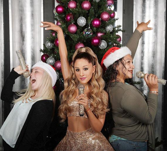 Fans singing with new wax figure of Ariana Grande at Madame Tussauds Las Vegas