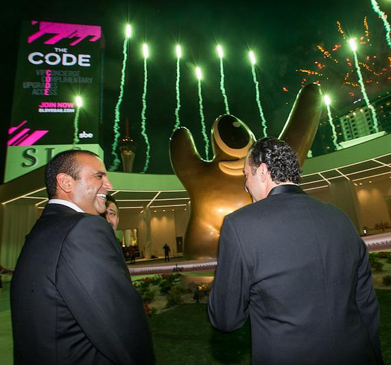 Arash Azarbarzin, President, sbe Hotel Group and Sam Nazarian, Founder, Chairman and CEO, sbe and Sam Bakhshandehpour, President, sbe watch fireworks at SLS Vegas grand opening