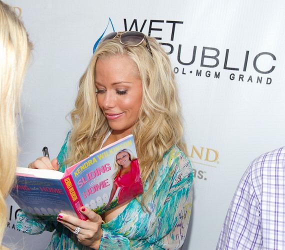 Kendra Wilkinson-Baskett with her book at WET REPUBLIC