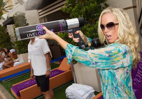 Kendra Wilkinson-Baskett with t-shirt shooter at WET REPUBLIC