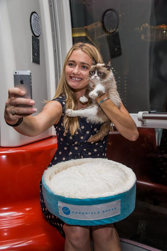 Grumpy Cat takes a selfie with a little help from owner Tabatha Bundesen