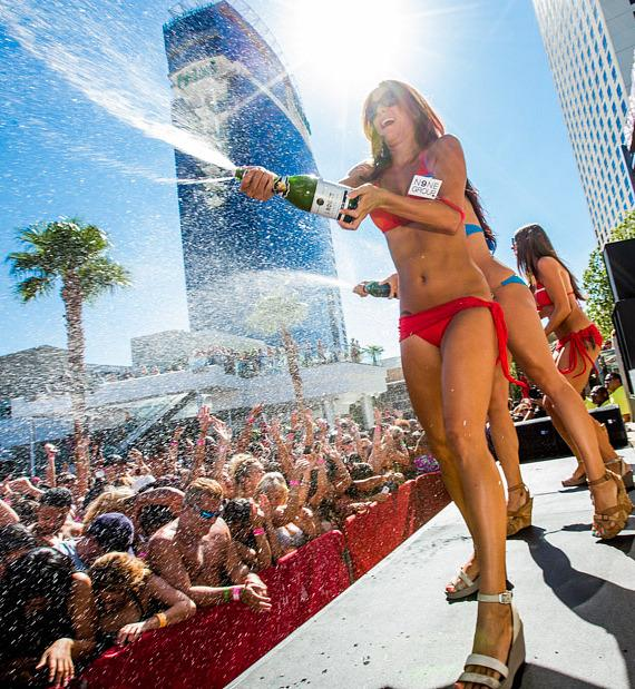 """Palms' gorgeous cocktail waitresses show off playful side while spraying """"Ditch Fridays"""" day clubbers with champagne"""