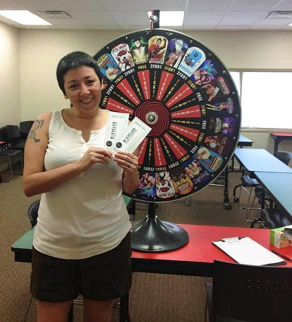 "Penny, who collected money in her adopted pig, ""Euro Piggy,"" and got a chance to spin the David Saxe Productions prize wheel. She won two tickets to see Recycled Percussion at The Quad Resort and Casino"