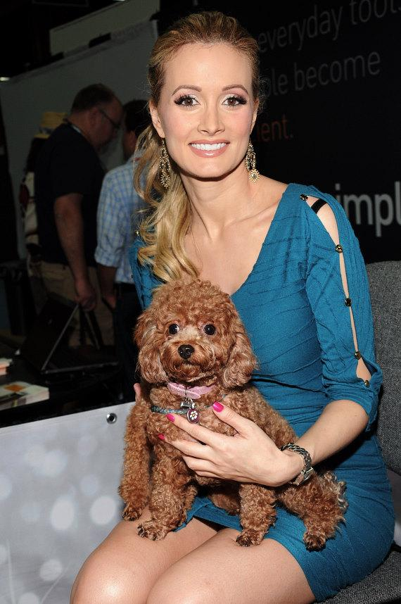 Holly Madison with a puppy at SuperZoo 2012 Convention at Mandalay Bay