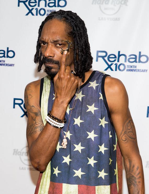 Snoop Dogg aka Snoop Lion on carpet at REHAB for End of Summer Bash