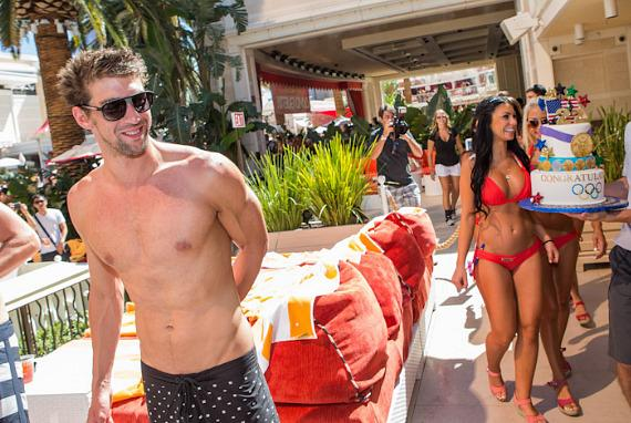 Olympian Michael Phelps is surprised with a cake at Encore Beach Club.