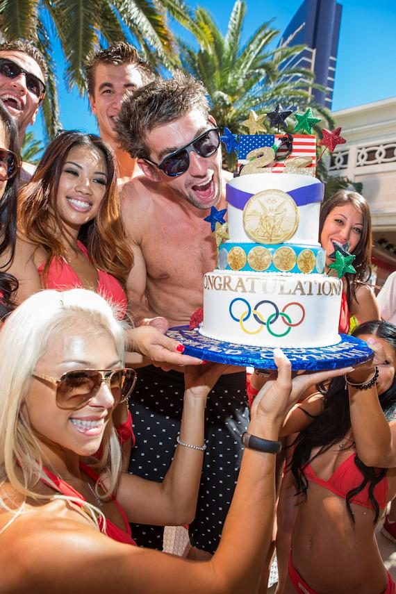Michael Phelps with retirement cake and Encore hotties